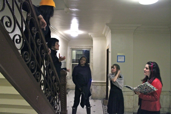 Vagina Monologues cast during rehearsal on the staircase in the main lobby of my building. (Photo by Patrick J. Paglen)